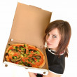 Portrait of young woman with pizza isolated on white — Stock Photo