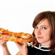 Young woman eating fast food — Stock Photo #9183970