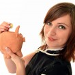 Woman putting euro in small piggy bank — Stock Photo #9183990