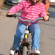 Little girl riding on her bike — Stock Photo