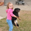 Little girl with dog — Stock Photo #9800350