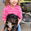 Little girl with dog — Stock Photo #9800356