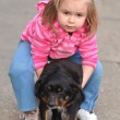 Little girl with dog — Stock Photo #9800362