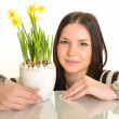 Woman with narcissus — Stock Photo #9913966