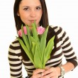Woman with pink tulips bouquet of flowers smiling isolated on white background — Stock Photo