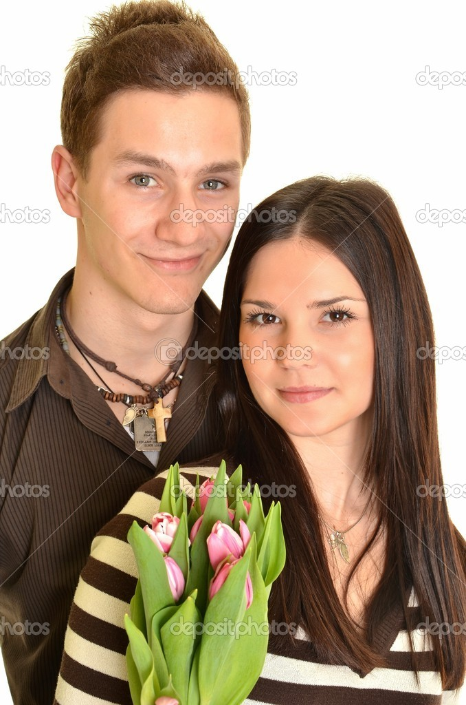Couple in love with tulips — Stock Photo #9997983