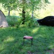 A tent, a car and a barbecue in the summer — Stok fotoğraf