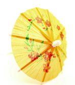 Yellow cocktail umbrella — Stock Photo