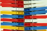Several colored plastic clothespins — Stock Photo