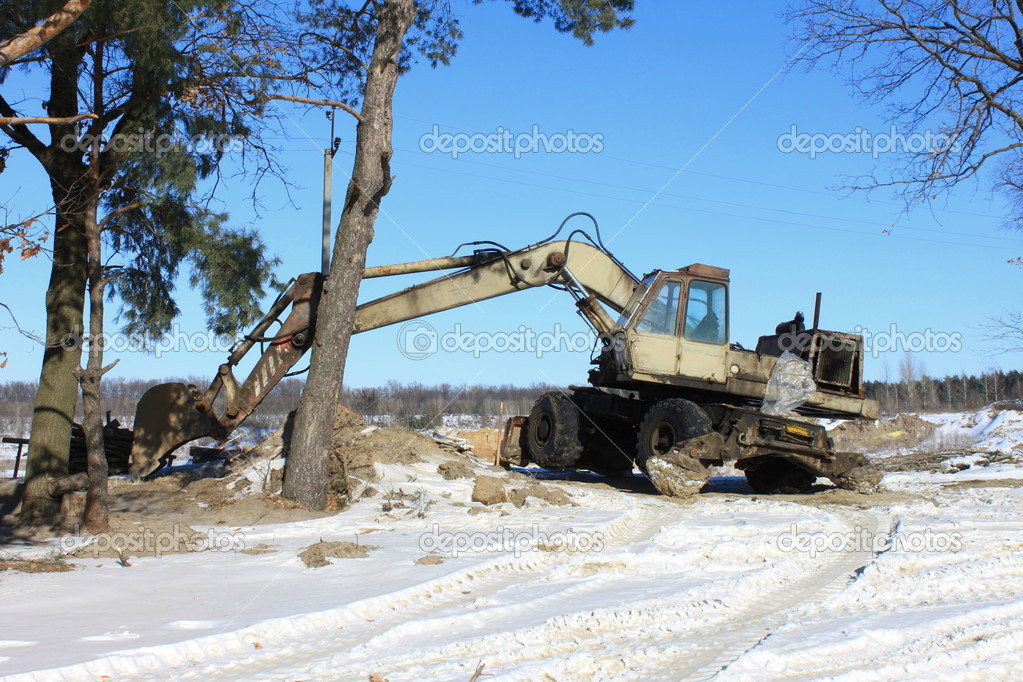 Old excavator on winter road  — Stock Photo #8869538