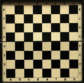 Black and white old empty chess board — Stock Photo
