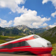 Fast train passing by mountain landscape - Foto de Stock