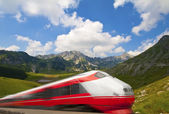 Fast train passing by mountain landscape — Stock Photo