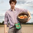 Young agriculturist on the cultivated field — Stock Photo