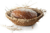 El pan en la cesta de mimbre vintage — Foto de Stock