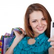 Beautiful woman with shopping bags and phone — Stock Photo #8024927