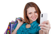 Beautiful woman with shopping bags and phone — Stock Photo