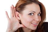 Jonge vrouw luisteren — Stockfoto