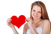 Smiling young woman holding a heart — Stock Photo