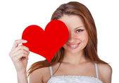 Young woman holding a heart — Stock Photo