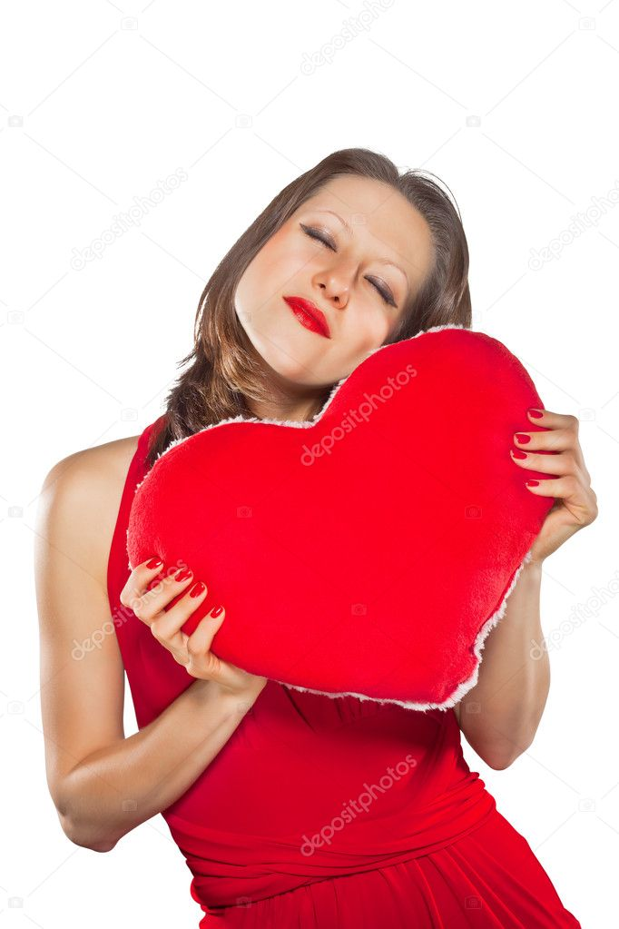 Beautiful woman with a gift of the heart in his hands isolated on white background — Stock Photo #8887725