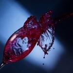 Wine splashing — Stock Photo