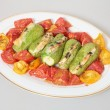 Stock Photo: Baked tomatoes and stuffed courgettes