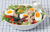 Nicoise salad and serving tools — Stock Photo