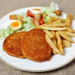 Breaded Chicken steak fries and salad — Stock Photo
