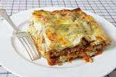 Lasagne slice with fork — Stock Photo