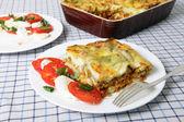 Lasagne verde and caprese salad — Stock Photo