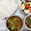 Beef curries with salad and rice - Stock Photo