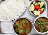 Beef curries with salad and rice — Stock Photo