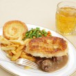 Steak and kidney pie with beer - Stock Photo