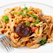 Eggplant in tomato sauce with pasta — Stock Photo