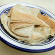 Arab flat bread or kubz - Stock Photo