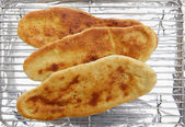 Baking naan bread — Stock Photo