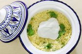 Couscous with yoghurt high angle — Stock Photo