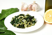 Swiss chard with garlic and oil — Stock Photo