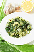 Swiss chard with garlic and lemon vertical — Stock Photo