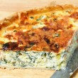 Spinach quiche on a board - Stock Photo