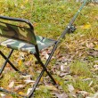 Fishing tackle ashore about a fishing chair — Stock Photo