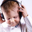 Young boy wearing telephone headset — Stock Photo