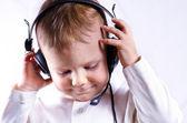 Young boy wearing telephone headset — Stock Photo