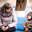 Mum and the son on a bench in a court yard — Stock Photo