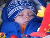 Baby sleeping in a stroller — Stock Photo