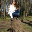 Girl on stump — Stock Photo