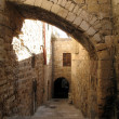 Old narrow street in historic part of Jerusalem, Israel - Stock Photo