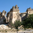 Uchisar cave city in Cappadocia, Turkey - Stock Photo