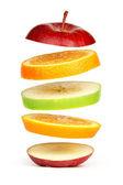 Levitating fresh sliced fruit — Stock Photo